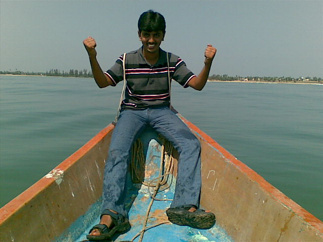 Me - sitting on the boat's edge