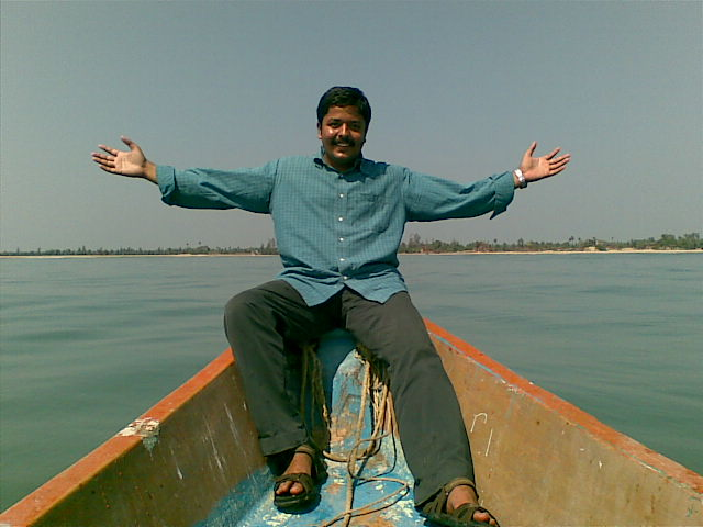 Arvindh - Posing from boat's edge